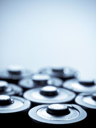 closeup of batteries, blue toned with vignette and shallow DOF,back lit and high contrast Stock Photo
