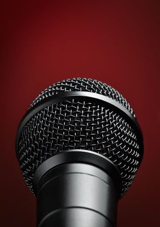 microphone  against red background, closeup shot with vignette