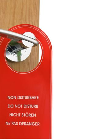 closeup of the opened door with do not disturb sign hanging on the door handle, isolated over white background for putting different scenes