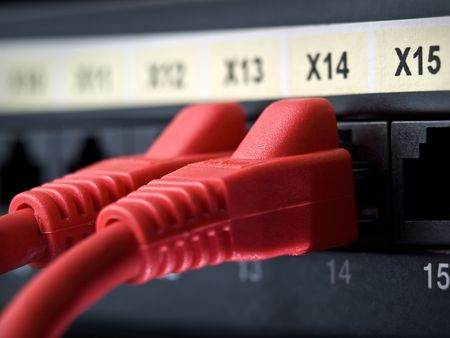 closeup shot of network cables plugged into the switch sockets , shallow DOF Stock Photo