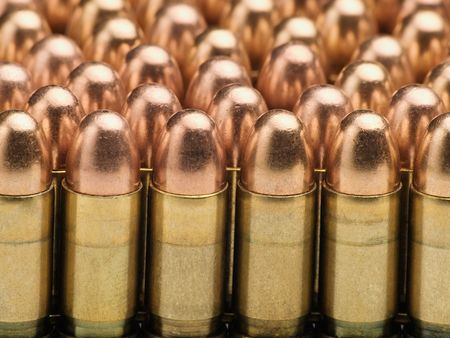 munition: rows of bullets, useful for backgrounds and themes involving crime,war,military,terrorism