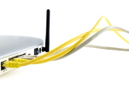 wireless adsl router  with network cables over white background