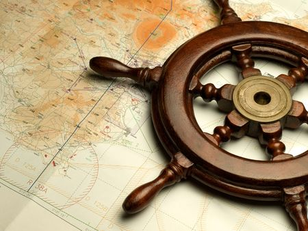 timone e carta nautica, utile per vari temi di navigazione o di viaggio Archivio Fotografico