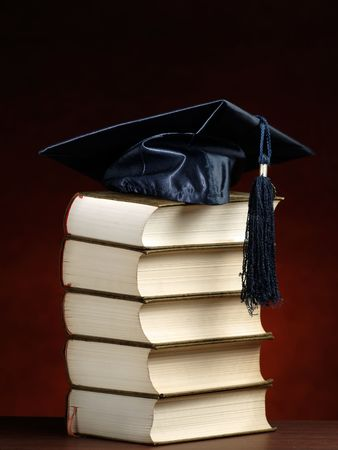 graduation cap on top of the stack of books, for various graduation,knowledge or education themes
