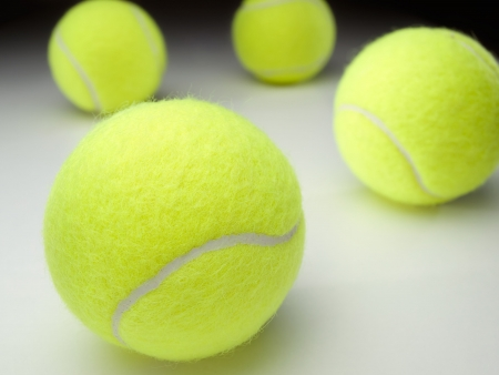 tennis balls on white surface ,for various tennis,recreation and sport themes 版權商用圖片