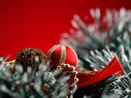 Christmas decorations over red background, closeup, for various christmas related themes and backgrounds 版權商用圖片