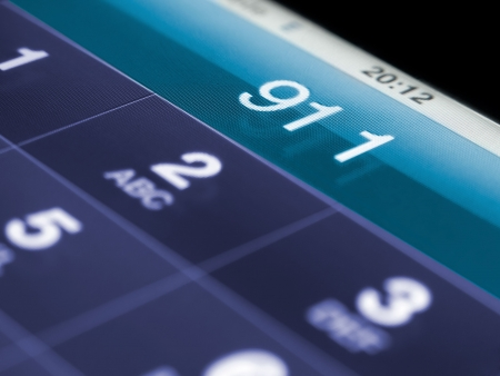 911 on the mobile phone,shallow DOF, for emergency and urgency themes 版權商用圖片 - 8175591