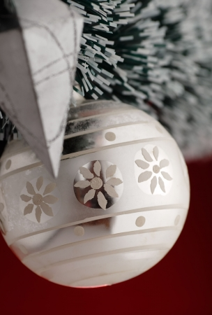 christmas decoration detail, focus on the ball, red background