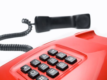 red telephone over white background, for communication,emergency or service themes