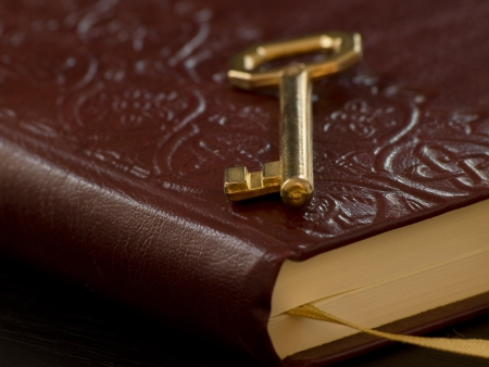golden key on the diary, closeup and shallow DOF,for security,access, or secret themes