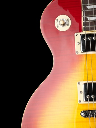 electric guitar body,closeup over black background, for music and entertainment themes photo