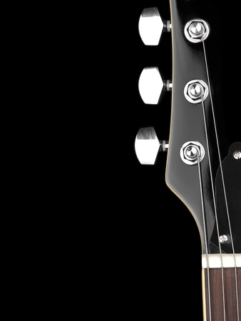 top of the guitar neck over black background, for entertainment or concert themes Stock Photo