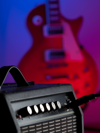 guitar amplifier with the electric guitar in the background,for entertainment and music themes
