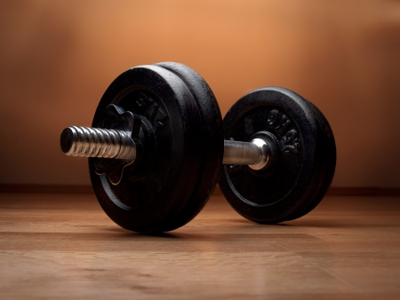 dumbbell on the wooden floor, closeup, for fitness or weight related themes Stock Photo - 8958650