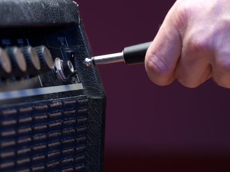 plugging into   the amplifier, closeup, for music,entertainment themes photo
