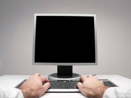 Male hands on the desktop computer keyboard with monitor black screen for copy space, for computing,internet,communication themes
