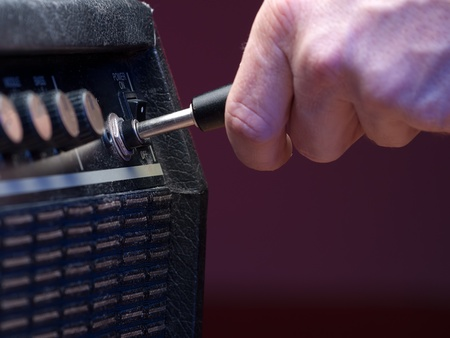 plugged into  guitar  the amplifier, closeup, for music,entertainment themes photo