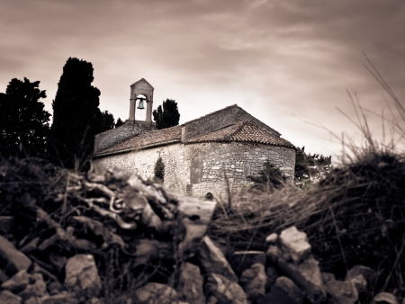 old stone made Mediterranean church on the cloudy weather town Osor, island Cres-Losinj,Croatia,Europe, sepia toned image 版權商用圖片