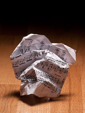 crumpled sheet: crumpled paper sheet of music notes on the floor, closeup,for music composition themes Stock Photo