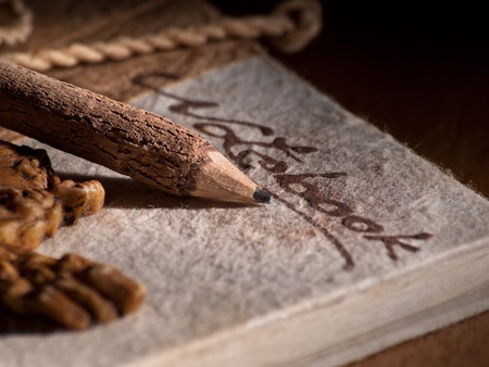 Wooden pencil on the old style notebook, closeup, for writing themes 版權商用圖片