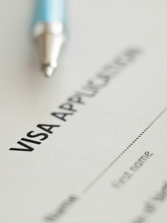 VIsa application form with pen, shallow DOF,for immigration,travel,social issues themes 版權商用圖片