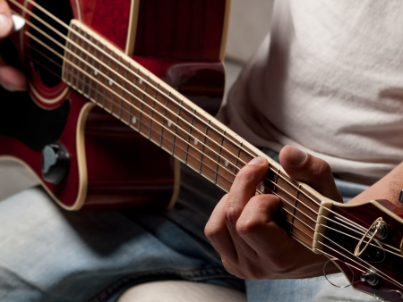 man playing guitar,closeup , selective focus,for entertainment,music themes 版權商用圖片