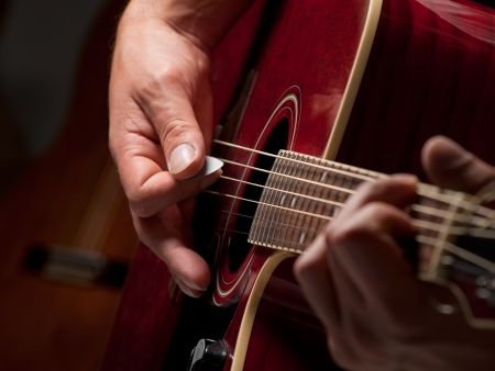 guitarist playing guitar in the studio ,closeup, for entertainment,music themes