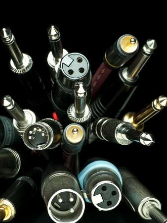 heap of various audio cables closeup, for audio,wiring or sound themes Stock Photo