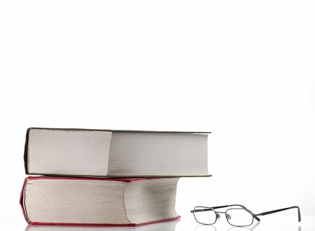 two books and the glasses over white background 版權商用圖片