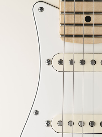 white electric guitar body closeup , for music and entertainment themes