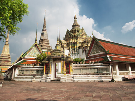 Buddhist temple Wat Pho on partly cloudy day, HDR image, Bangkok,Thailand