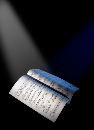 Music paper sheets under the reflector lights , black background
