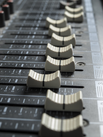 Mixing deskfaders , for music and sound , entertainment themes