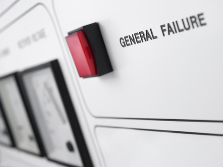 closeup shot of the red alert failure lamp with focus on the related text  on the power unit, shallow DOF, useful for concepts such as power breakdown,overload, or other malfunction topics