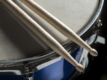 snare: Drumsticks resting on the snare drum, for music,entertainment themes
