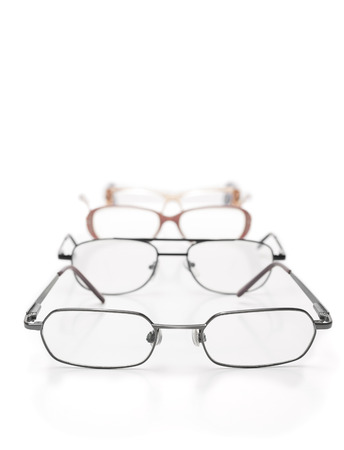 testing vision: Eye glasses in on the table over white background,for medicine,eye testing, vision themes Stock Photo