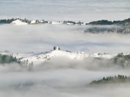 Hills covered with snow and  fog, for weather,winter themes,Slovenia, Europe