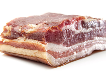Bacon over white background close up , for food, diet, health themes 版權商用圖片