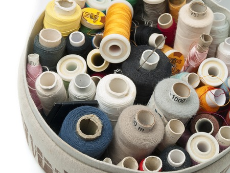Thread spools of various colors with needle, for sewing,clothing themes 版權商用圖片