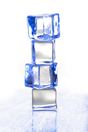 Clear blue ice cubes on the ice surface, for cold, winter related themes 版權商用圖片