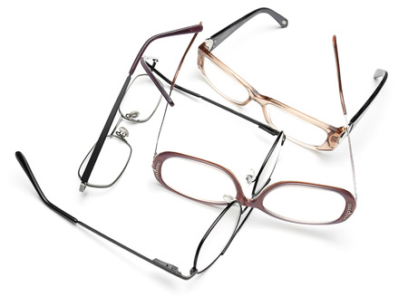 Eye glasses scattered in on the white background,for medicine,eye testing, vision themes