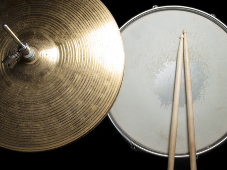 Worn drumsticks on the snare drum and hi-hat, for music,entertainment themes 版權商用圖片