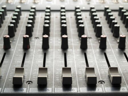 Mixing desk, back lit,  , for music and sound , entertainment themes 版權商用圖片