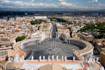 View from the St. Peters Basilica. The Vatican is sunlit, whereas the Rome part is covered by clouds.