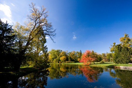 Lednice-Valtice cultural heritage - view of a park with autumn trees and a river.