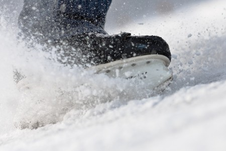 winter break: Aggressive breaking ... skates on ice Stock Photo
