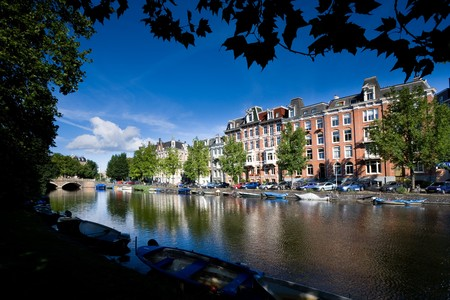View of a channel and buildings in Amsterdam, Netherlands. Stock Photo