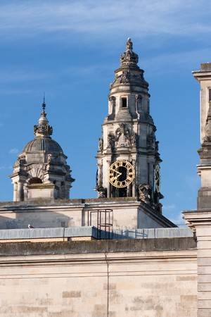 Two tower tops, one with clocks, in Cardiff, UK. Stock Photo - 7799517