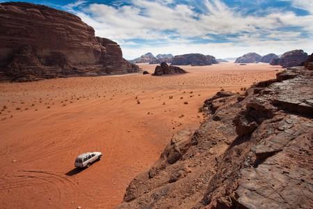wadi: Anonymous car in the sand of Wadi Rum reservation, Jordan. Stock Photo