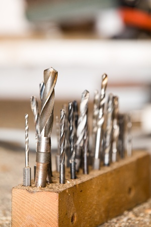 Detail of drills on workshop table, shallow focus photo